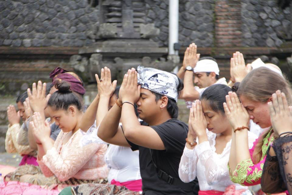 student praying in bali