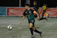 UOG Men's Soccer Captain Dylan Naputi takes the ball down field