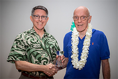 University of Guam President Thomas W. Krise presents Father Francis X. Hezel, the 37th speaker of the Presidential Lecture Serieson Jan. 22, 2019, with a gift of appreciation.