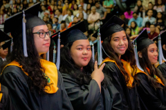 UOG Graduates smiling for the camera