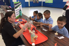 Clarissa Barcinas preparing food portions for children as part of the