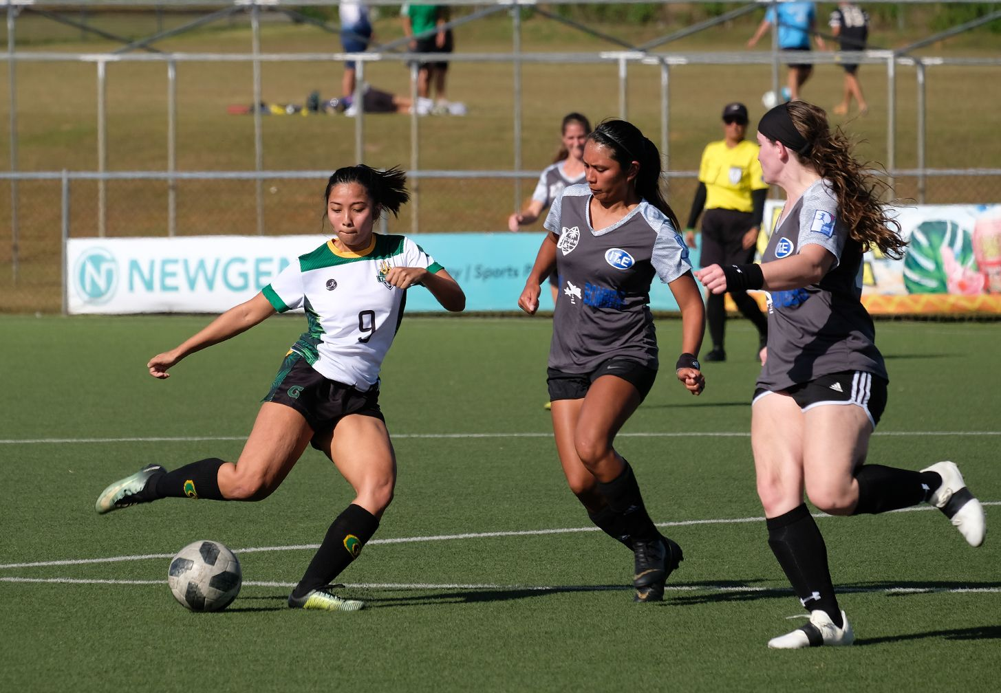 UOG's Ariya Cruz, No. 9, moves the ball upfield against two opponents. Cruz scored two of UOG's six goals in the March 10 match.