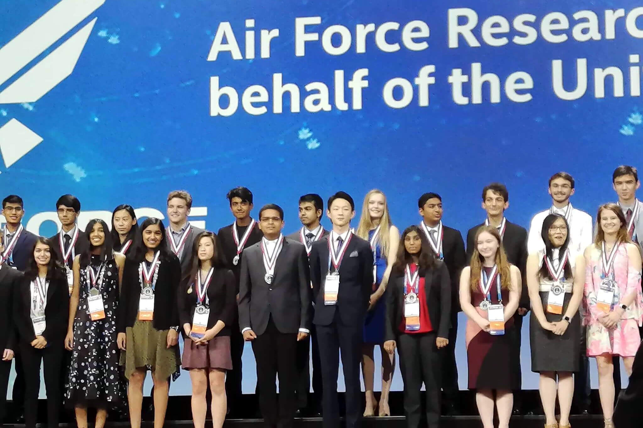 Daniel Z. Kang stands with other winners at the Intel International Science and Engineering Fair