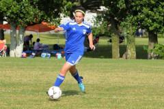 Gracia Magrath dribbles a soccer ball