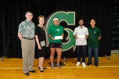 The University of Guam presented two $1,000 scholarships on Oct. 28, 2018, to two UOG Triton soccer players