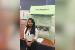 Kiara Dela Rosa poses in front of her science fair project