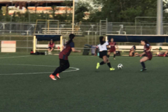 The University of Guam Lady Triton's Soccer Team dominated the Bank of Guam Lady Strykers with their speed and footwork