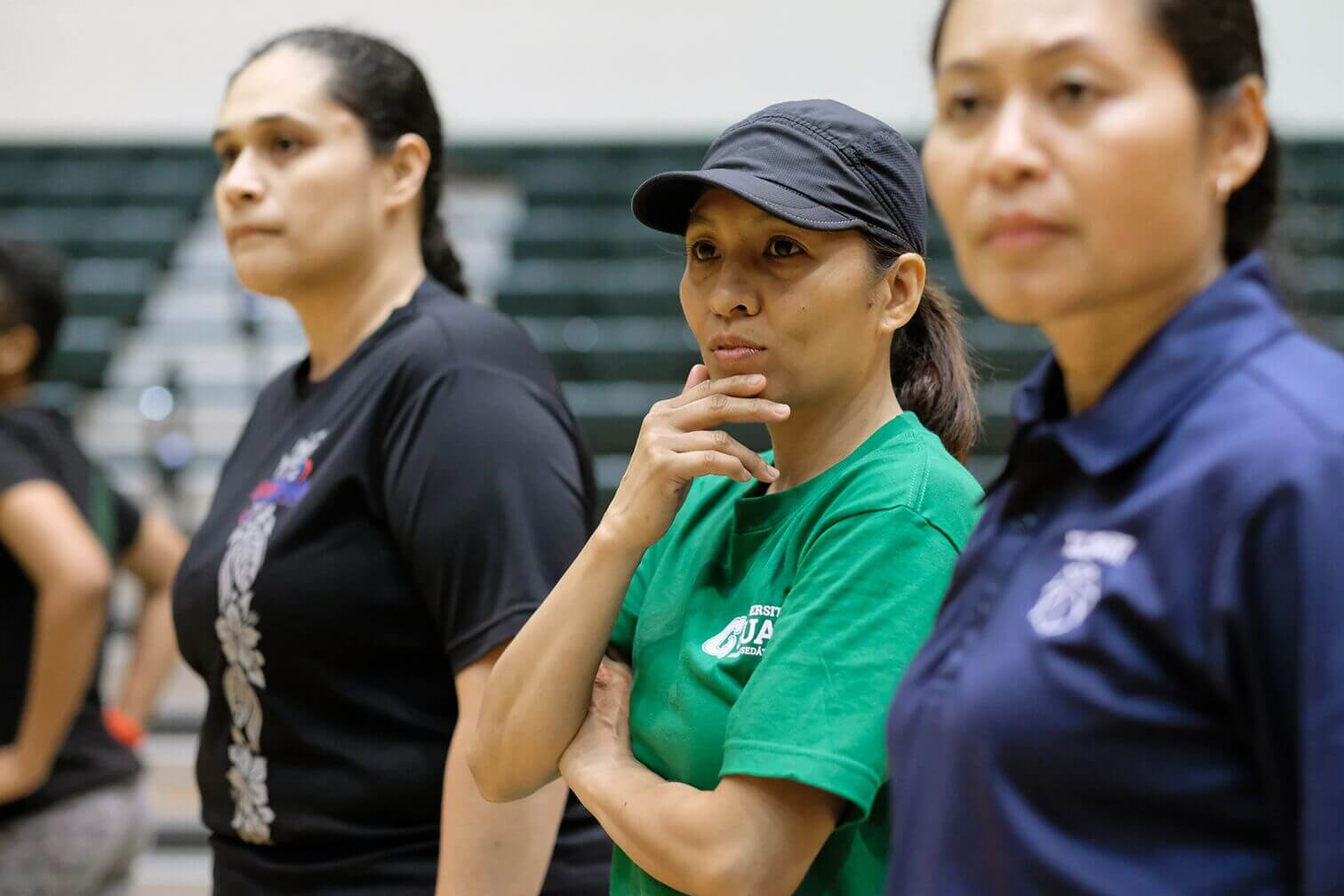 Coach Cecile Olandez and Susan Rechebong Lupola oversee tryouts