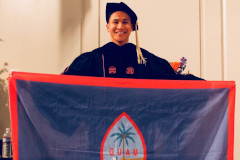 Mark Vincent Yu holding the Guam flag