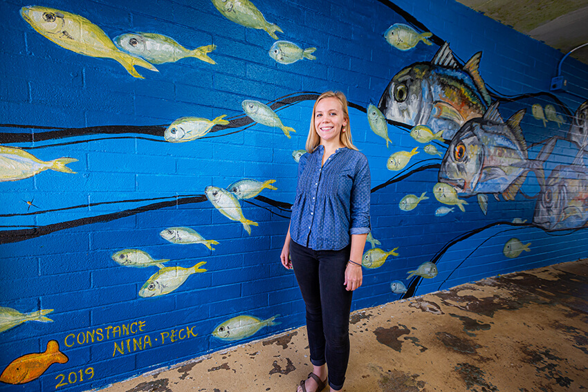 Sartor painted a mural in an outdoor hallway at the Marine Lab along with graduate student Nina Peck