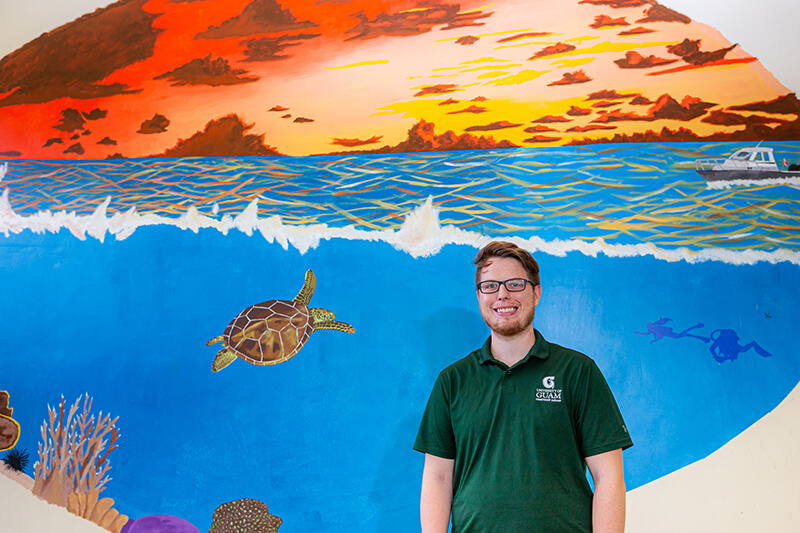 Graduate student Justin Berg is in the process of completing a mural in the Marine Lab boat shop