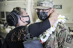 Cadet Amos Dumapat being congratualted by his family