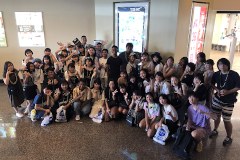 UOG students and Otakanomori High School students particpiating in a photo scavenger hunt in Tumon.
