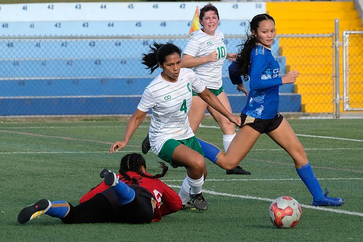 The Triton Women's Soccer Team in a game against Guam Women's Shipyard.