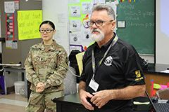 John Howerton, the recruiter for the UOG's ROTC program, with ROTC cadet Jeanie Nguyen