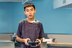 Photo of Andrew Lu flying a Tiny Whoop aircraft