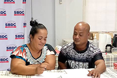 Sepe Tolenna and Tolenna M. Tolenna map a business plan during Startup Weekend Micronesia in Kosrae.