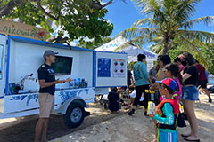 Phil Cruz gives a lesson from the Tasi Outreach Trailer