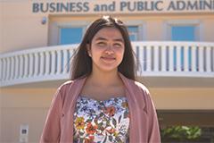 Photo of Tiera Santos in front of the SBPA building