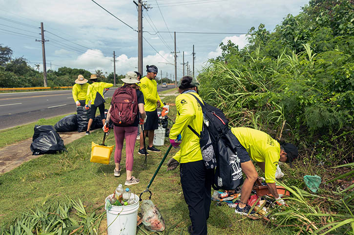 Members of the G3 Conservation Corps at a roadside cleanup