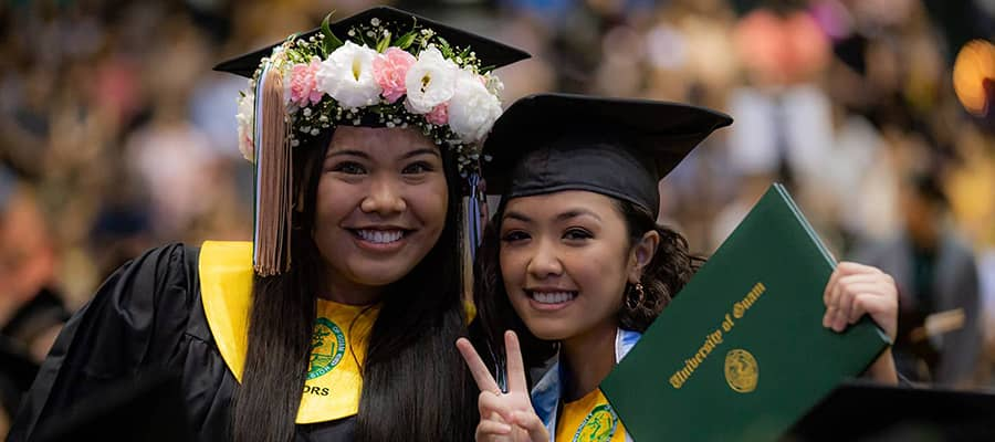 Photo of two female Triton students during commencement