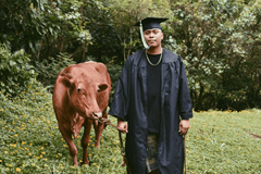 His whimsical, non-traditional graduation photo holds a deeper story of his upbringing.