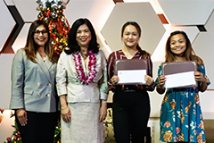University of Guam seniors Regina Manuntag and Krizia Raqueno each received a $2,000 scholarship on Dec. 6 from the Guam's Women's Chamber of Commerce.